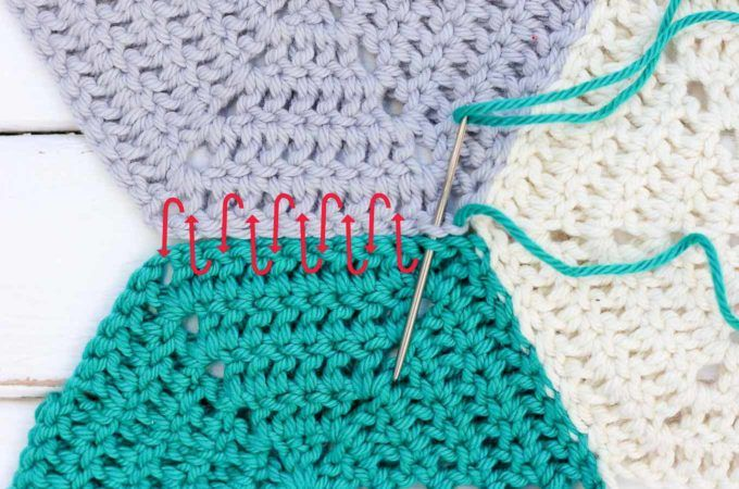 This photo tutorial will show you how to join crochet hexagons with a technique that results in an invisible seam. Great for sewing hexagons together, but can also work for granny squares or other crochet pieces. | MakeAndDoCrew.com
