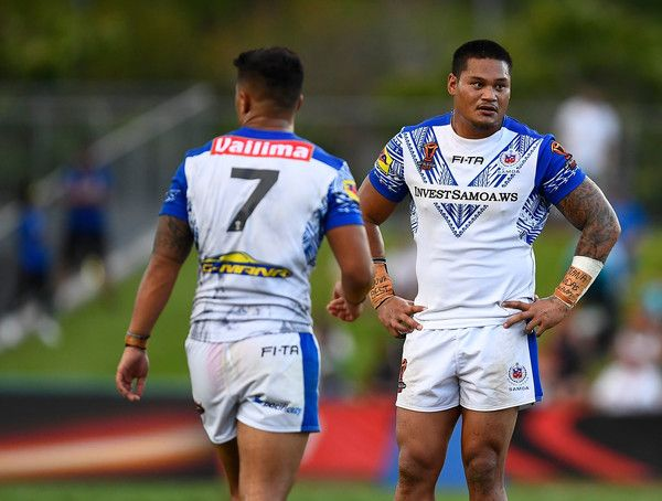 Canberra Raiders Joseph Leilua (r) of Samoa looks dejected after drawing  the 2017 Rugby League World Cup match between Samoa and Scotland at Barlow Park on November 11, 2017 in Cairns, Australia.