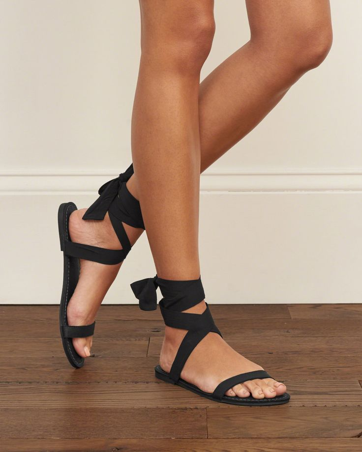 Soft and comfortable faux leather footbed with wrap ribbon ankle strap, Imported