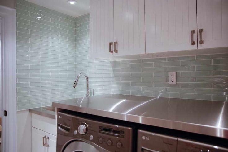 white cabinets next to clear glass tile shows hint of green