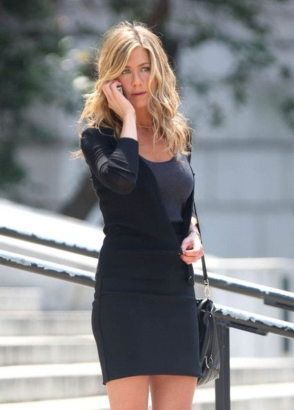 Jennifer Aniston Cardigan - Jennifer Aniston was casual-chic in a black cardigan and a matching mini skirt while filming 'The Bounty.'