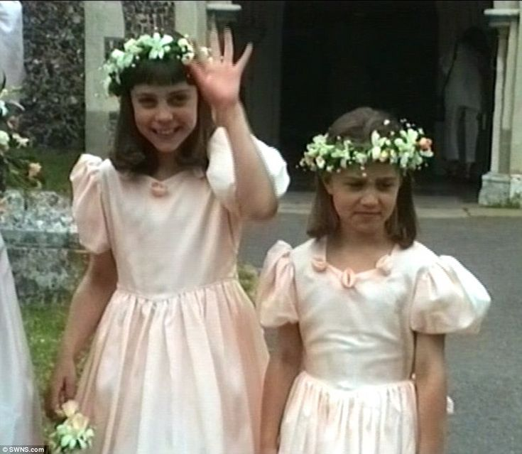 The future Duchess of Cambridge (left) gives a cheery to the camera as she plays a starring role as bridesmaid at her Uncle Gary Goldsmith's 1991 nuptials, alongside her sister Pippa (right)