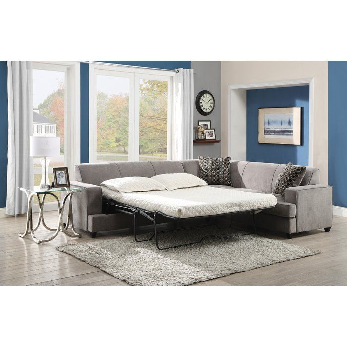 This sectional sofa with sleeper mattress features a clean and tidy style that will have your home looking updated and uncluttered. It features straight lines throughout its frame and is edged by thick track arms, a token element of contemporary furniture designs. The seat cushions are removable allowing for easier cleaning while the back cushions remain in place. Wooden feet and the three included accent pillows supply simple details to the piece that are decorative but don't make this s...