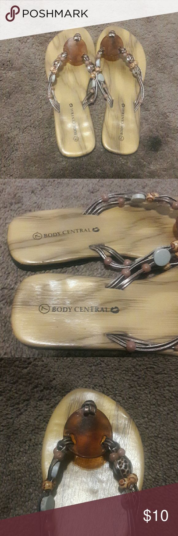 BODY CENTRAL FLIP FLOP SANDALS BODY CENTRAL FLIP FLOP SANDALS, size 7 in very good condition, with different colors it make then so cute. BUNDLE AND SAVE 20% OPEN TO OFFERS 🤗 Body Central Shoes Sandals