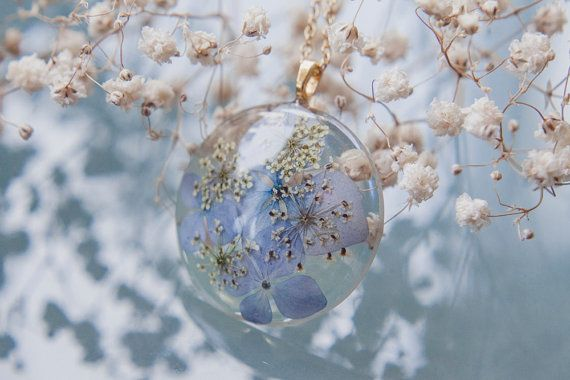 Nature inspired botanical necklace featuring blue hydrangea and queen anne's lace encased in clear resin - made by Floral Joy Jewelry