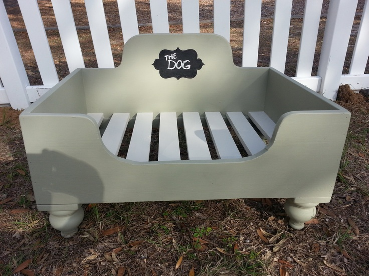 Beautiful hand-crafted made-to-order wooden dog bed, complete with painted-on chalk board for pets name or fun comment. Link to Etsy shop