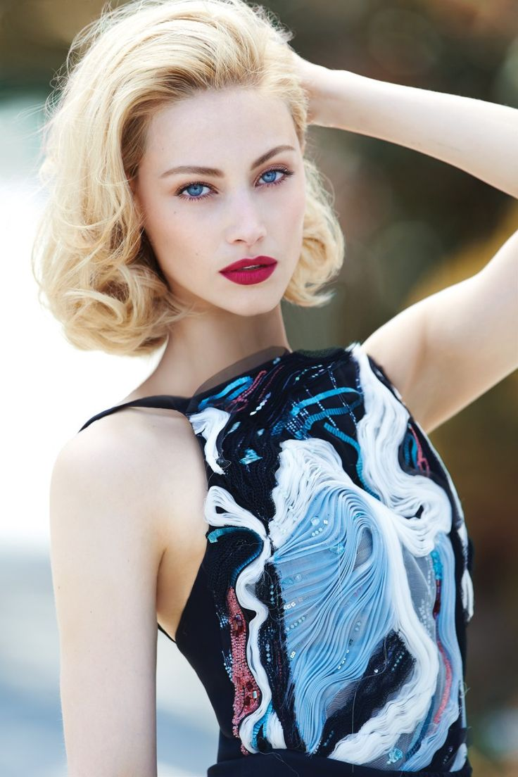 Sarah Gadon wears a top and makeup by #GiorgioArmani. On skin, Maestro Fusion and Fluid Sheer; On eyes, eye tint; and on lips, Rouge Ecstasy.