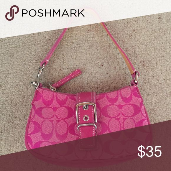 Coach purse Pink coach purse - excellent condition. Zipper on top with cute buckle over the top Coach Bags