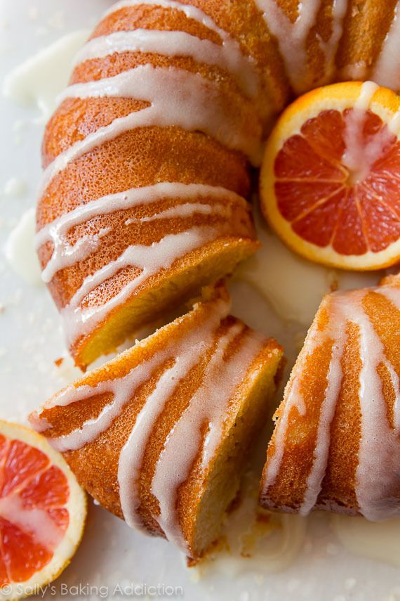 Bright, flavorful, CRAZY moist, and tender orange bundt cake! Find the recipe on sallysbakingaddiction.com