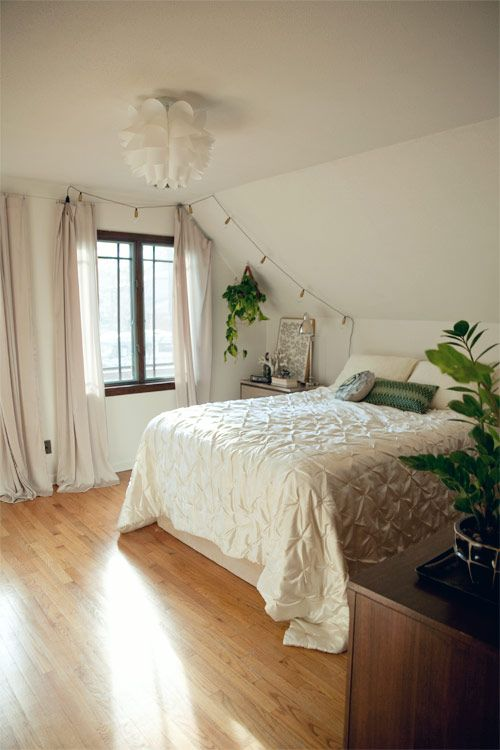 Calm, textural bedroom w fairy lights and greenery.  Perfection. via Wit & Whistle Blog