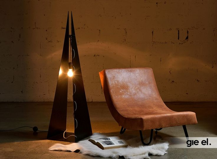 Modern floor lamp, made form bent steel. Steel lamp. Gie El Home.