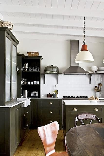 Green cabinets, similar flooring, but I'm not sure I like the whole look