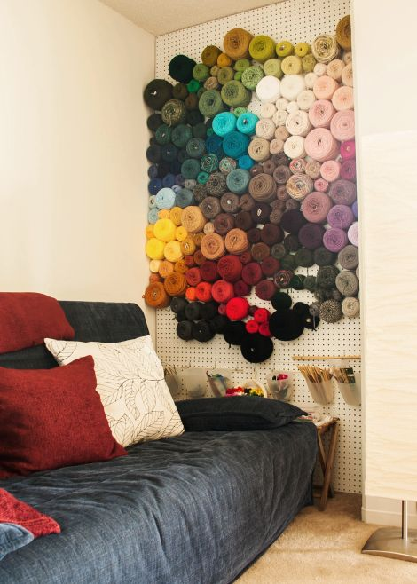 Amazing yarn storage.  Wooden pegs hooked to wall and there you go!