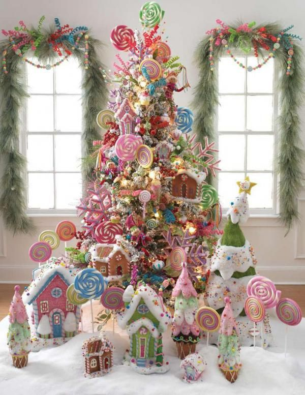 Candy themed Christmas tree. Why not make the Christmas tree, a Christmas treat? Stack up your treats and form them into this amazing and colorful looking mountain of sugar and sweets.