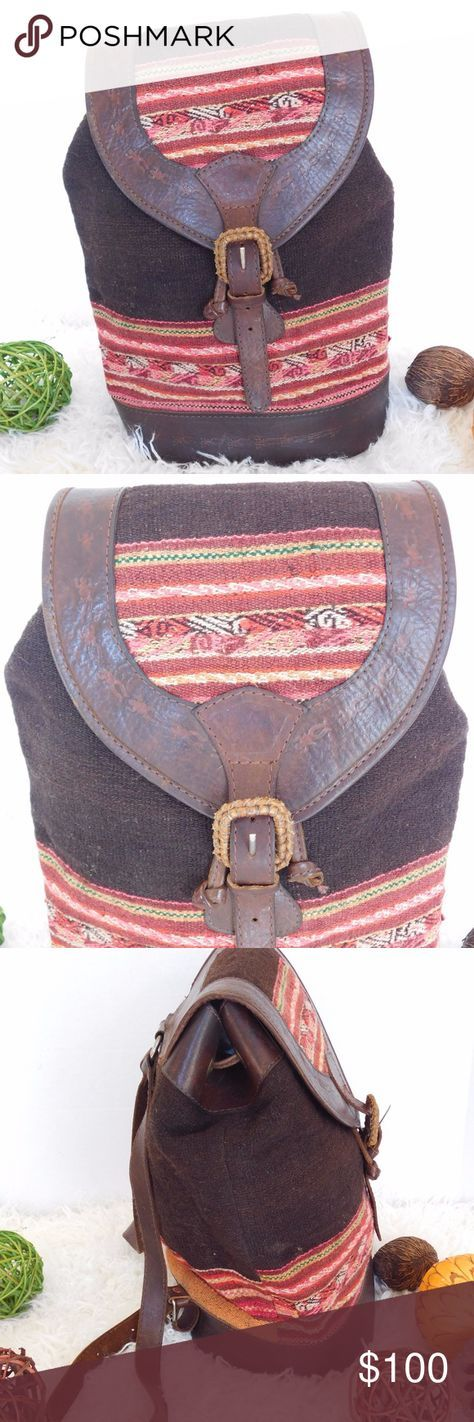 "VINTAGE LEATHER ETHNIC AZTEC WOVEN WOOL BACKPACK BRAND- BHL MADE IN BOLIVIA COLOR- BROWN/MULTI MATERIAL- LEATHER/WOOL STYLE- BACKPACK SIZE- 12"" length, 16"" height, 7.5"" width FEATURES-EMBOSSED PRINT, BUCKLE CLOSURE INSIDE- FULLY LINED CONDITION- PRE-OWNED VINTAGE, VERY GOOD, NO ISSUES Bin- PB 13 BHL Bags Backpacks"
