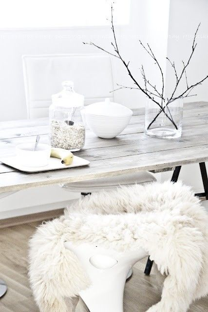 ♥ branches !!!!!!!!! and faux fur on modern chair. MMMM looks good with that pale wood table.