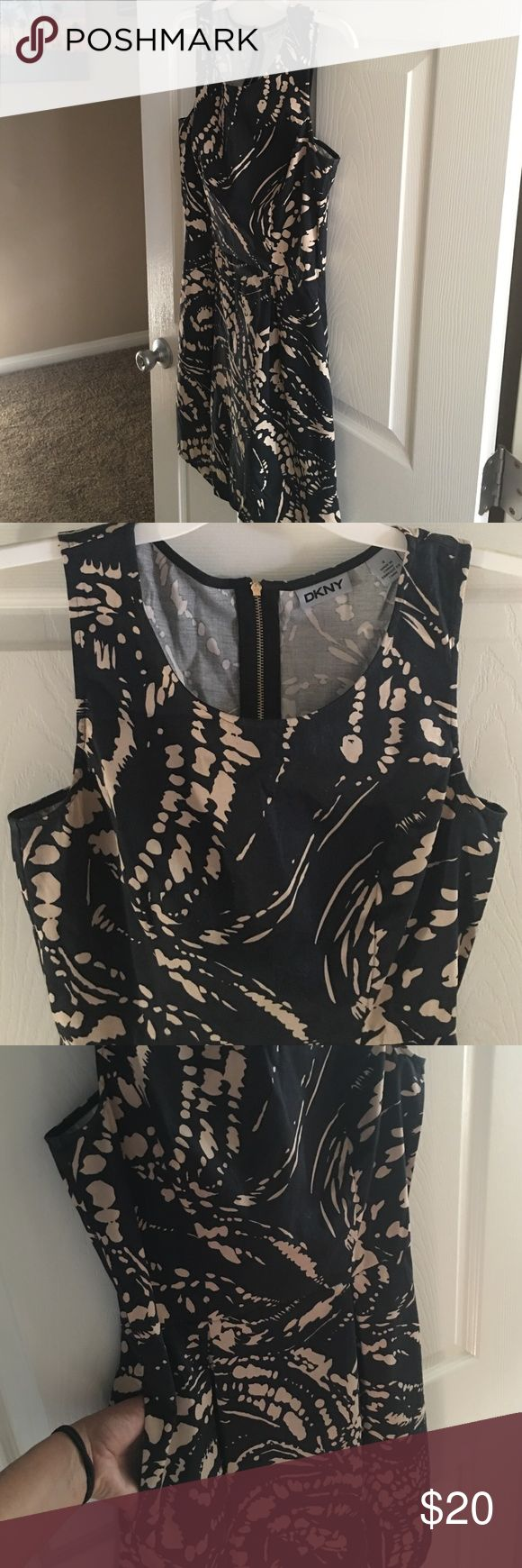 DKNY SHIFT DRESS Smart sexy and fun. This DKNY dress is perfect for the office. Front pleats and side pockets! Gold zipper down the back. Worn gently once or twice. Like new!  Black with tan detail DKNY Dresses Midi