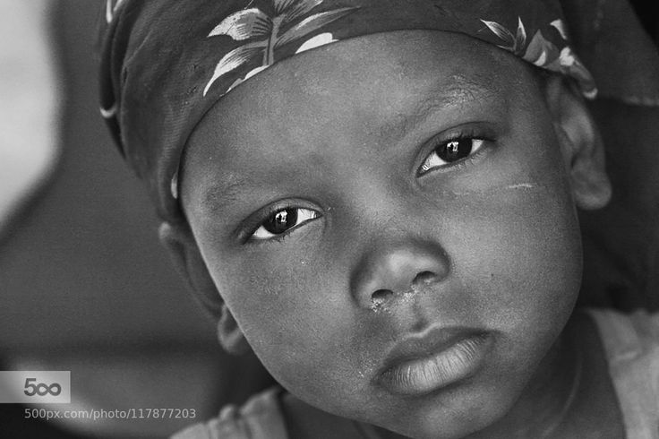 A Child of Niger West Africa - Pinned by Mak Khalaf A young child in Niger's capital city of Ouagadougou sadly looks at the camera. Black and White AfricaAfrican girlBabasteveNigerOuagadougouSteve EvansWest Africablack and whitechildcloseupeyesfacegirllittle girlportrait by babasteve