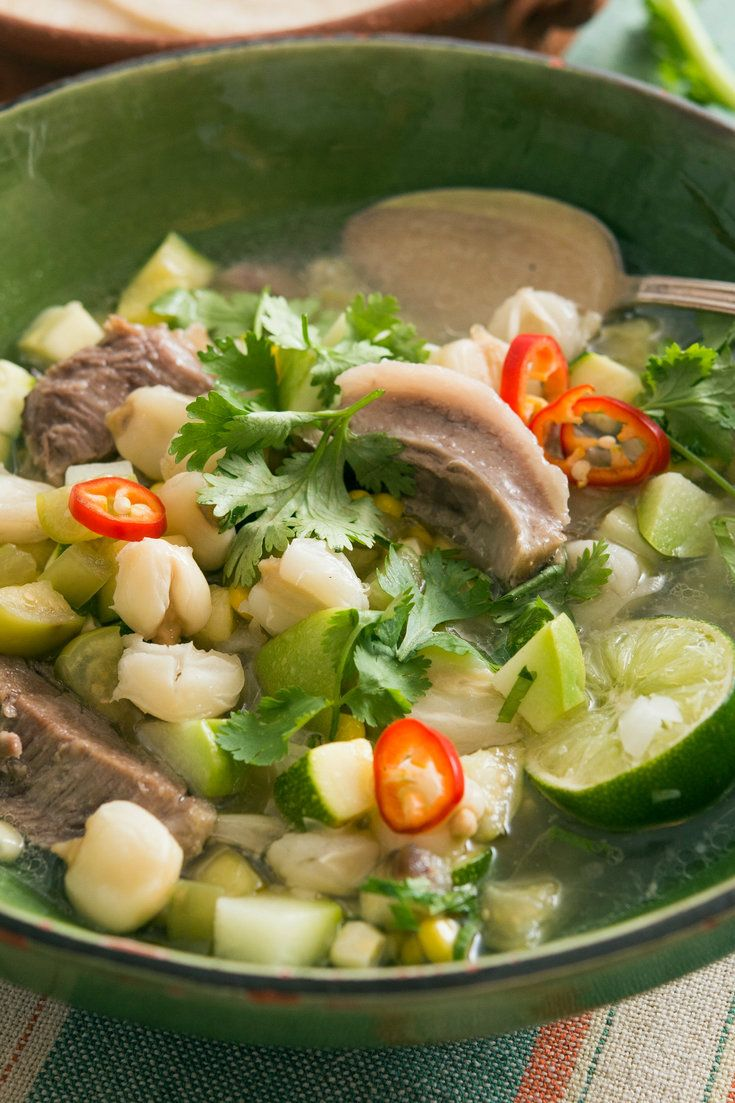 NYT Cooking: In most towns in Mexico, street vendors set up food stalls on summer evenings. Head for the pozole stand for bowls of brothy pozole verde, a stew of large hominy kernels simmered with pork. As opposed to pozole rojo, made with red chiles, this lighter, herby version makes a great summer supper. Set out bowls of condiments — chopped onion, cilantro, chopped chiles, avoc...