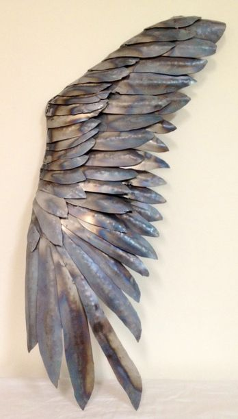 Inspiration for the aluminum siding. Welded wing sculpture... Would love a wooden version