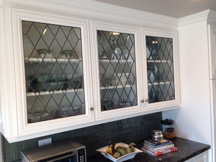 We added new leaded, beveled glass panels to these new cabinet doors during a full kitchen remodel.