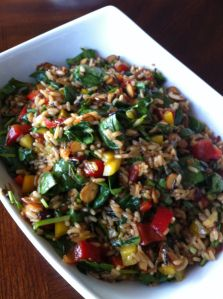 Spinach Rice Salad: 1 box Long Grain and Wild Rice 1/2  red, yellow, green bell pepper 1 bunch green onions 1 c toasted almonds  4 T olive oil 2 -3 T balsamic vinegar 1 T minced garlic 1 t dry mustard or 1 t dijon pinch of sugar salt & pepper  6-8 oz. bag or fresh spinach, torn into pieces. Prepare rice cool in fridge. mix liquids sugar and spices to vegies add cooled rice