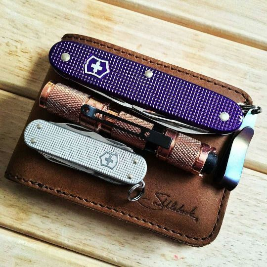 Everyday Carry with Swiss Army knives and Saddleback Leather Co. wallet.