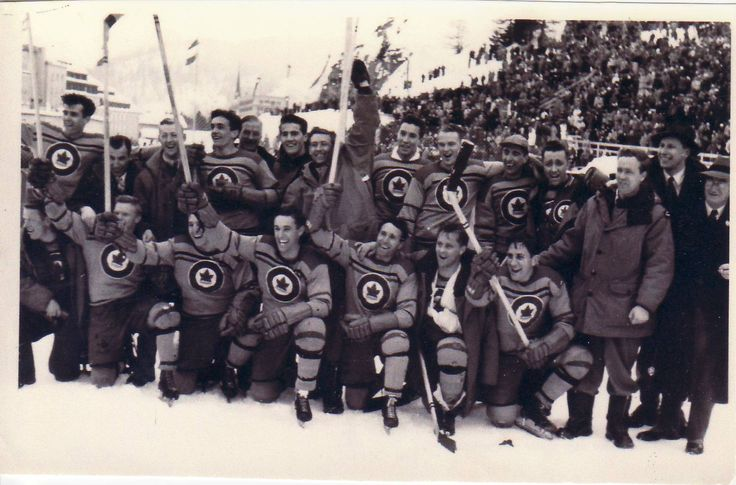 the rcaf flyers celebrate their gold medal win over switzerland on the outdoor rink at st
