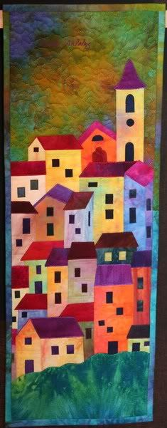 Use this idea and use layout of houses from picture from ship on vacaton?    Alicia Merrett - Wouldn't be the same if it wasn't done in hand dyed fabrics!