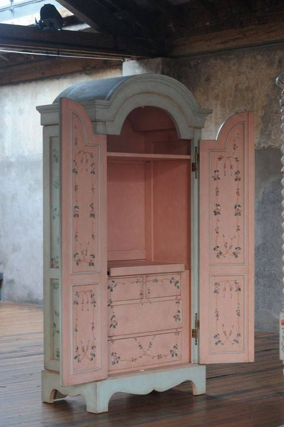 This large Armoire is hand painted outside & in.It looks so lovely& feminine that it would be perfect in a young lady's bedroom.