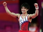 Kohei Uchimura of Japan celebrates after completing the floor exercise