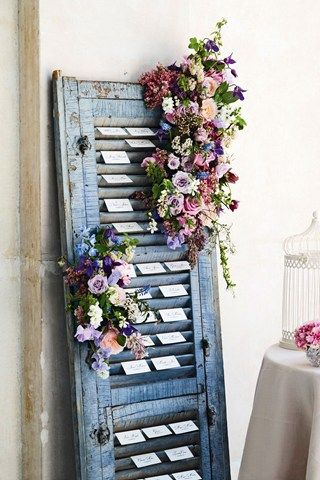 escort cards on the green shutter in the chateau - decorated with lavender and babys breath