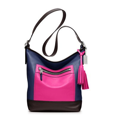 Coach Legacy Colorblock Leather Duffle. This will match my pink leather  coach gloves. My next bag!  27e6ff5f5f39d