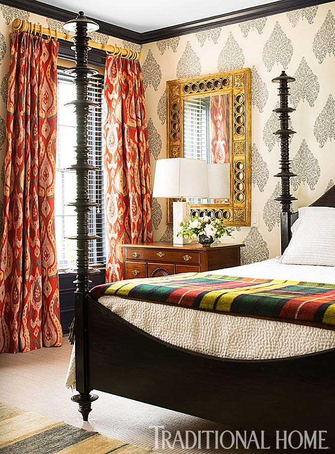 Large-scale patterned wallpaper in quiet colors give the bold drapery panels room to shine in this master bedroom. - Photo: John Bessler