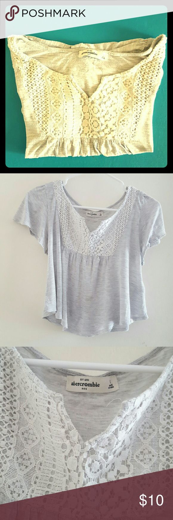 ABERCROMBIE Girls Crop Top Adorable Abercrombie kids crop top for girls. It's flowy with really cute lace detail at the top. It's a very light Heather gray and the lace is white. It's made from a nice thinner cotton blend. Perfect for those hot months! There's a little stain as seen in the photo but hardly noticeable. abercrombie kids Shirts & Tops Blouses