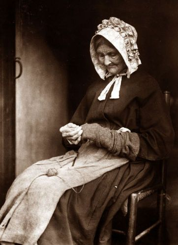:::::::: Vintage Photograph :::::::: Old woman darning socks in Whitby.  Photograph by Frank Sutcliffe.