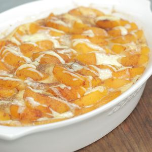 Jazz up traditional French toast with sweet peaches and heavy cream in this make-ahead breakfast casserole dish.