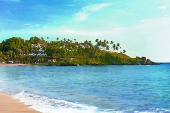 Best beaches of Kerala  Kovalam with the Leela Kovalam Beach hotel in the background