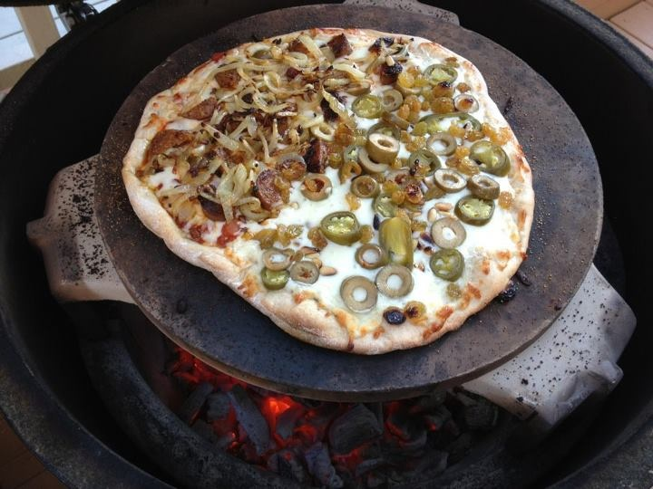 pizza with sun-dried tomato, caramelized onion, olives, pine nuts ...