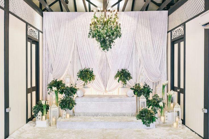 All white pelamin with fresh eucalyptus leaves. #wedding #velvetdrapes #garden