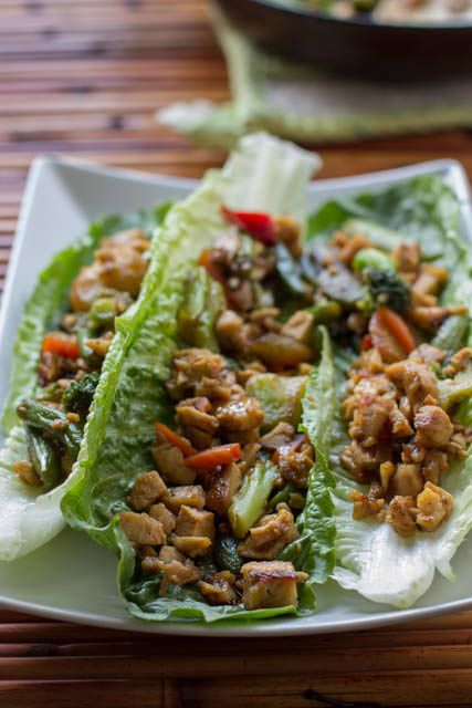 Asian Lettuce Boats loaded with delicious veggies and chicken that's ready in less than 30 minutes and as good as your favorite takeout! ohsweetbasil.com