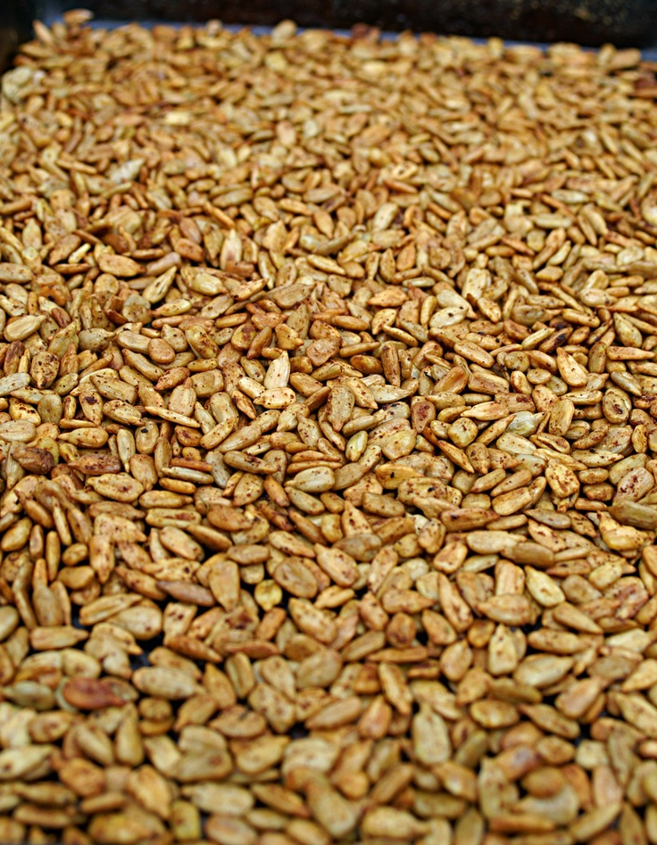 Spicing up sunflower seeds by combining 3 tbsp of brown sugar, 1 tbsp of chili powder, 1 tsp of ground cumin, 1/2 tsp of cinnamon, a pinch of ground cloves, 1/2 tsp  cayenne pepper, 3/4 tsp of salt and 3/4 tsp of dried chili flakes. First toss the hulled sunflower seeds in one beaten egg white (this will help the spices to stick to the seeds) then add the spices and toss to coat. Roast as normal.