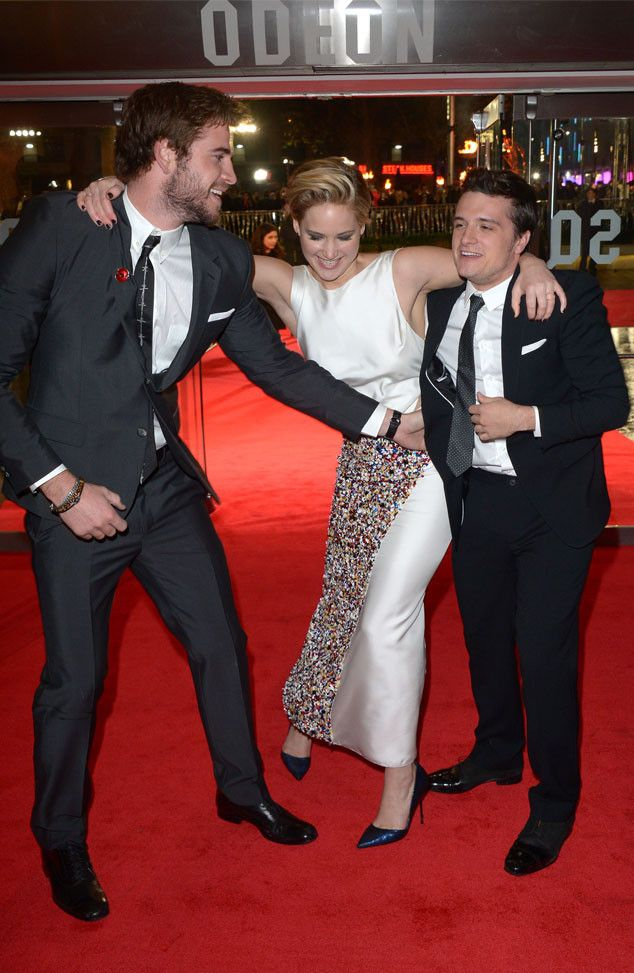 Liam, Hemsworth, Jennifer Lawrence & Josh Hutcherson in London from Hunger Games: Catching Fire Premieres Around the World | E! Online