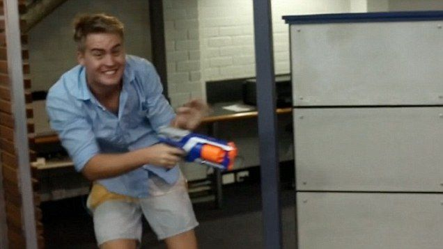 The coolest workplace ever? Employees take part in an epic battle of Nerf Wars around the office.