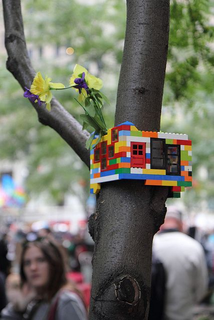 "Lego tree house. This would be a different idea for creating a ""Winter Friendly"" #geocache in a tree. It wouldn't exactly be tight though, so you'd need to put the log in a container to keep it dry. The Lego colours would also stand out rather much in the woods. Does Lego come in forest camo? #MakerMadness"