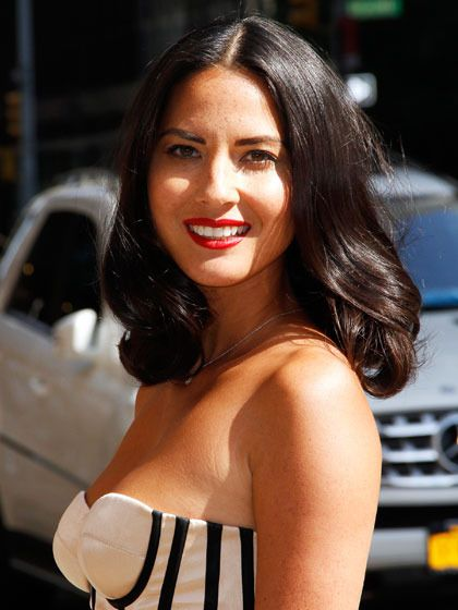 Olivia MunnHigh shine is what brings a blowout from basic to bombshell, says Fugate, whose celebrity clientele includes Munn. To get her look, apply a volumizer to damp hair (Fugate likes Shu Uemura Art of Hair Ample Angora Volumizing Light Foam). Then blow-dry hair in sections with a round boar-bristle brush, which adds shine.