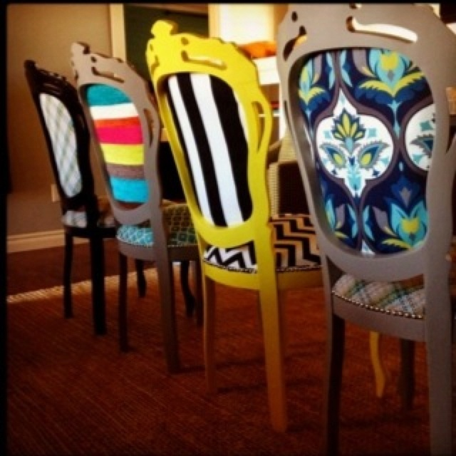 Love this mismatched chair idea--would change some of the fabric but overall cute