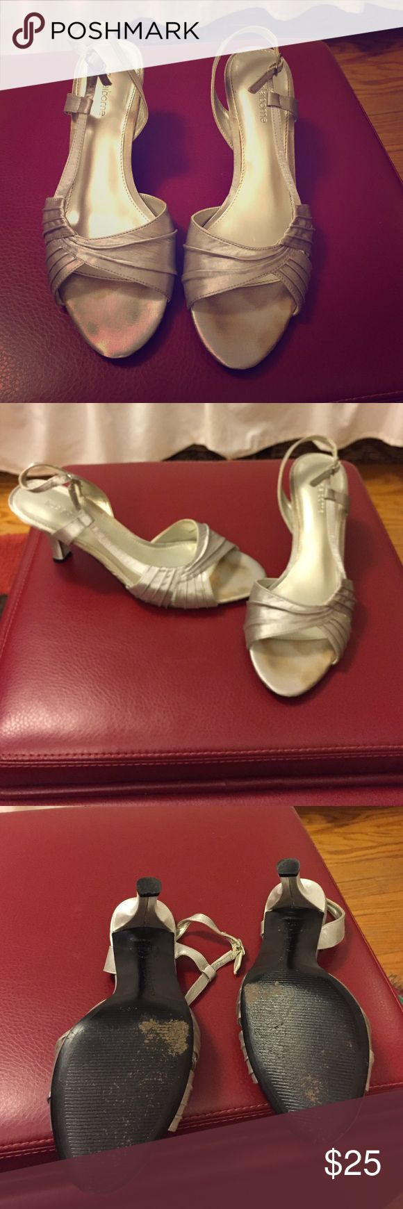 Silver sandals Liz Claiborne Silver satin sandals. Worn once for a wedding.  There are slight stains on the toe area but you can't see them when your feet are in them. Liz Claiborne Shoes Sandals