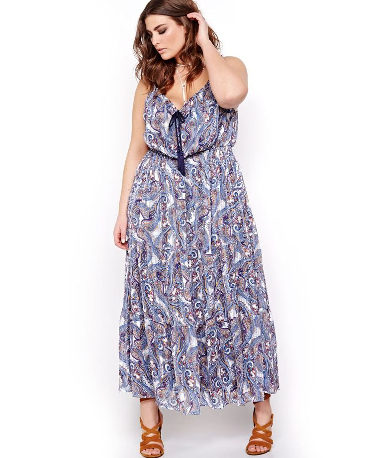 So trendy and flattering! Here's a maxi dress that you'll want to wear all the time. It's a plus size dress made of lined fabric with a tiered cut. Great for slim and shaped silhouettes. Split neck with tassel, sleeveless, ruched waist, all-over print, spaghetti straps, 56 inch length. Love & Legend.