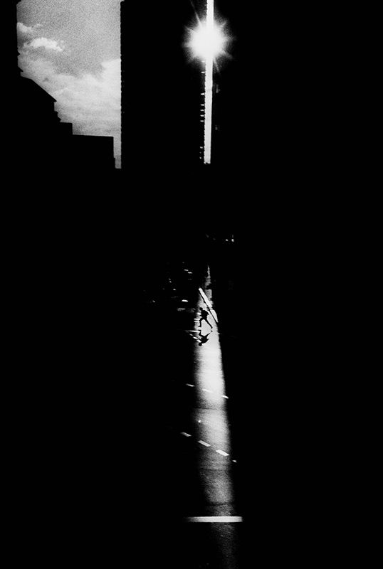 Photographer: Trent Parke (Untitled // Cat16, 2001) ~ This image includes a sense of drama never seen before. Light direction in combination with 'the decisive moment', Parke has captured a beautiful setting in it's full capacity of composure. I intend to draw from a similar sense of drama in my images.